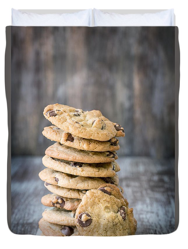 Bake Duvet Cover featuring the photograph Stack Of Chocolate Chip Cookies With One Leaning Kitchen Art by Carol Mellema