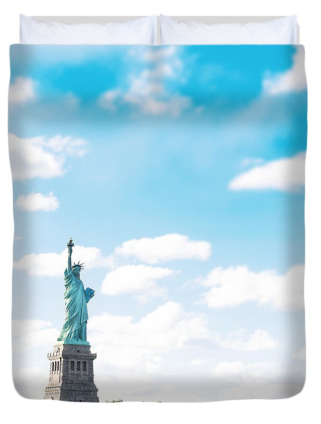 Lower Manhattan Duvet Cover featuring the photograph Statue Of Liberty On New York City by Franckreporter