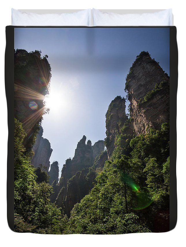 Scenics Duvet Cover featuring the photograph Sun Flare In Zhangjiajie Canyon by Universal Stopping Point Photography