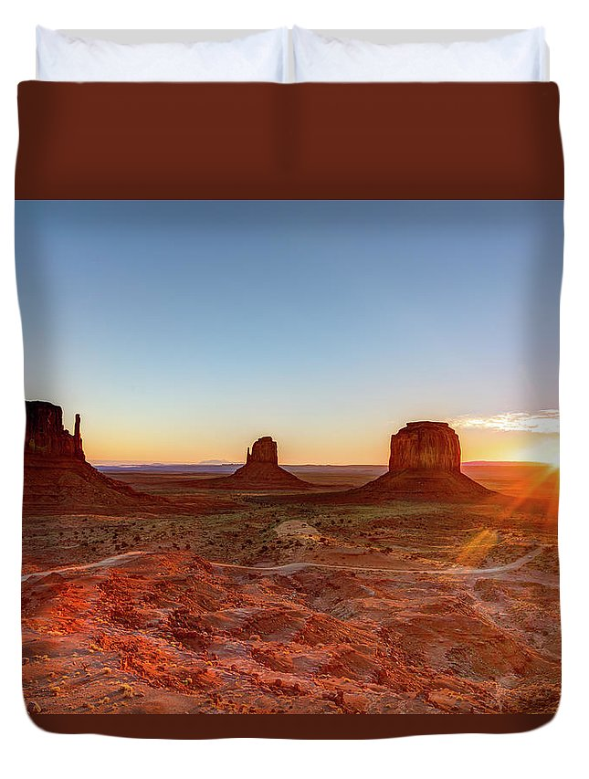 Tranquility Duvet Cover featuring the photograph Sunrise On Monument Valley by Loic Lagarde