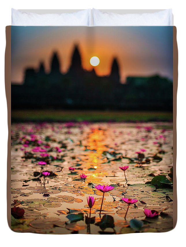 Tranquility Duvet Cover featuring the photograph Sunrise Over The Lotus Flowers Of by © Francois Marclay