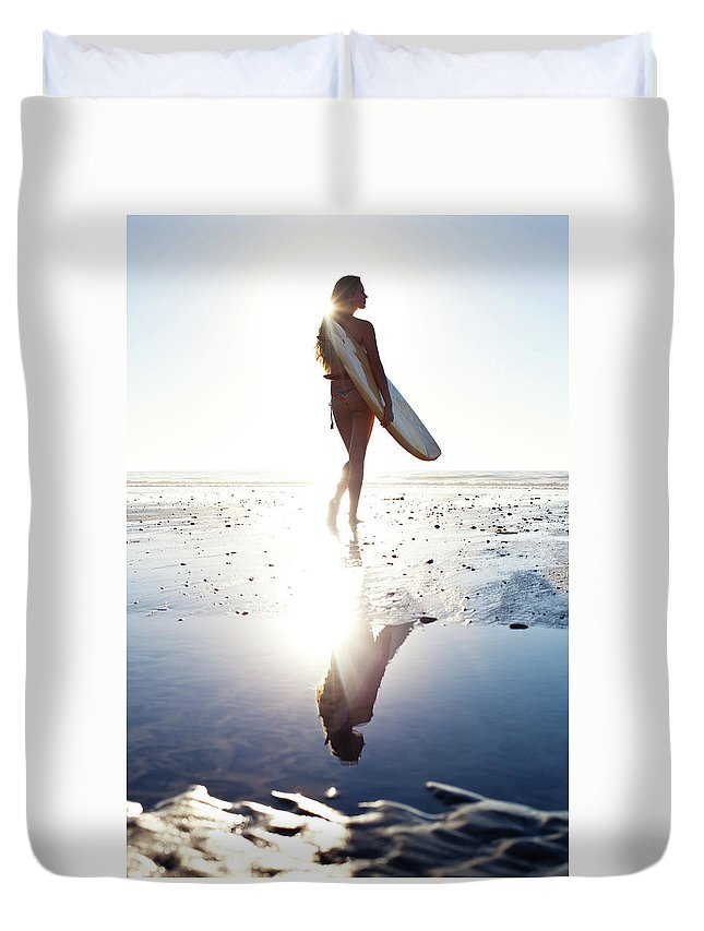 Youth Culture Duvet Cover featuring the photograph Surfer Girl by Ianmcdonnell