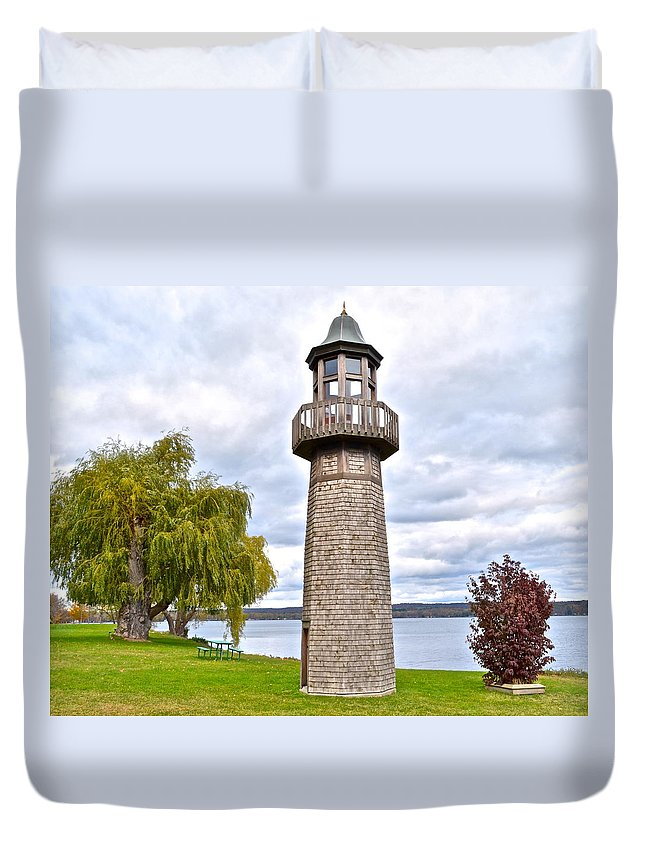 Surreal Duvet Cover featuring the photograph Surreal Lighthouse by Frozen in Time Fine Art Photography