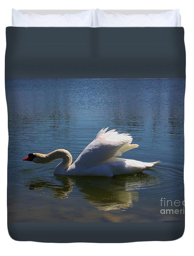 Swan Duvet Cover featuring the photograph Swimming Swan by Robert D Brozek