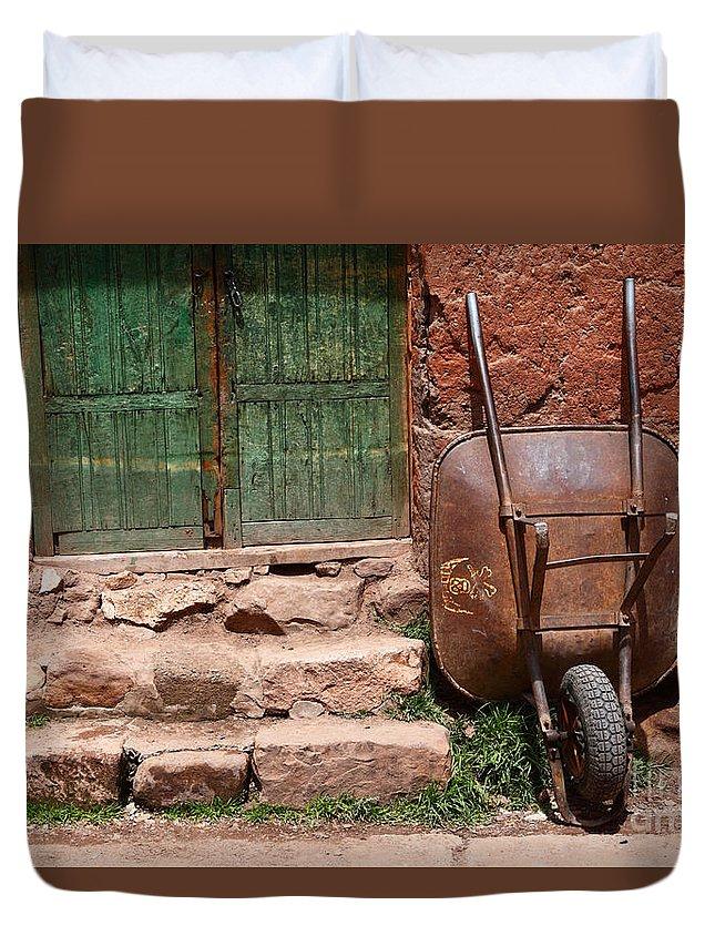 Wheelbarrow Duvet Cover featuring the photograph Rusty Wheelbarrow And Green Door by James Brunker