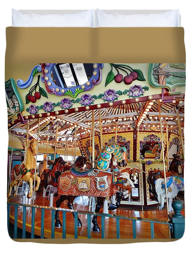 Carousel Duvet Cover featuring the photograph The Carousel Ride by VLee Watson