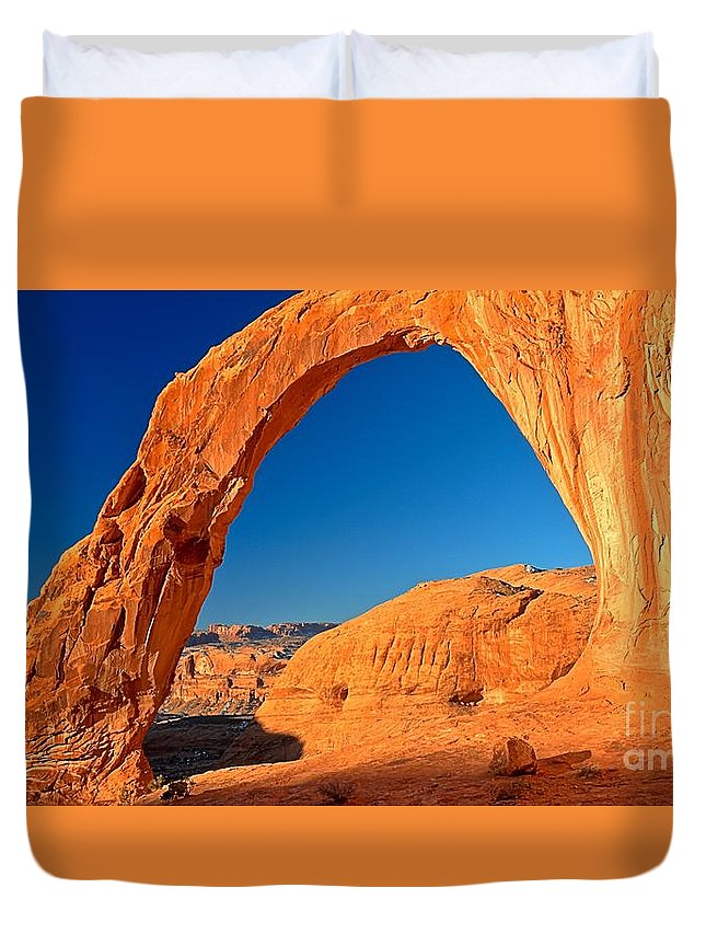 Corona Arch Duvet Cover featuring the photograph The Corona Glow by Adam Jewell