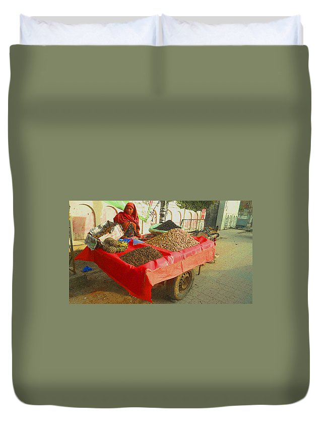 Expressive Duvet Cover featuring the photograph The Dried Fruit Seller by Lenore Senior