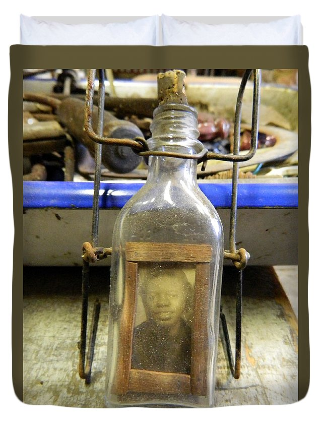 Bottle Duvet Cover featuring the photograph The Face In The Bottle by Kathy Barney
