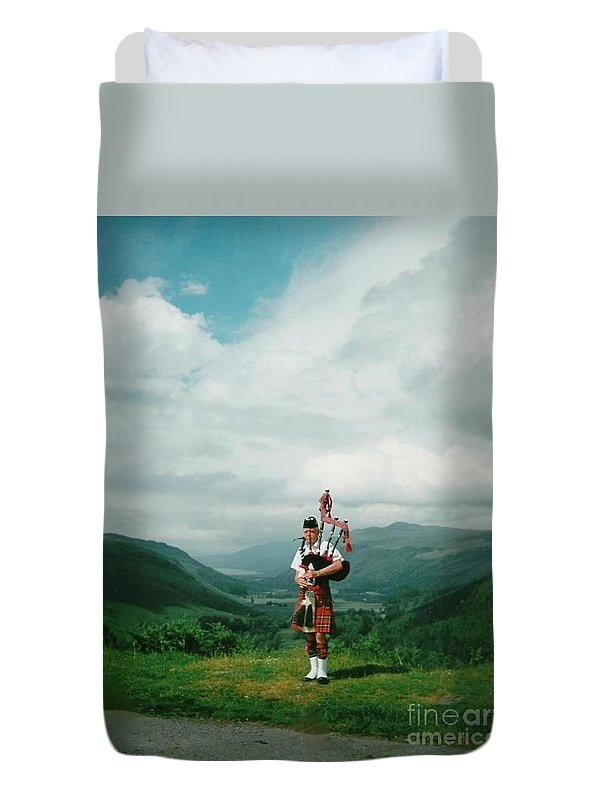 Piper Duvet Cover featuring the photograph The Piper At The Great Glen by Joan-Violet Stretch