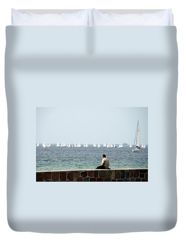 Warnemunde Duvet Cover featuring the photograph The Sailor With No Boat by Richard Rosenshein