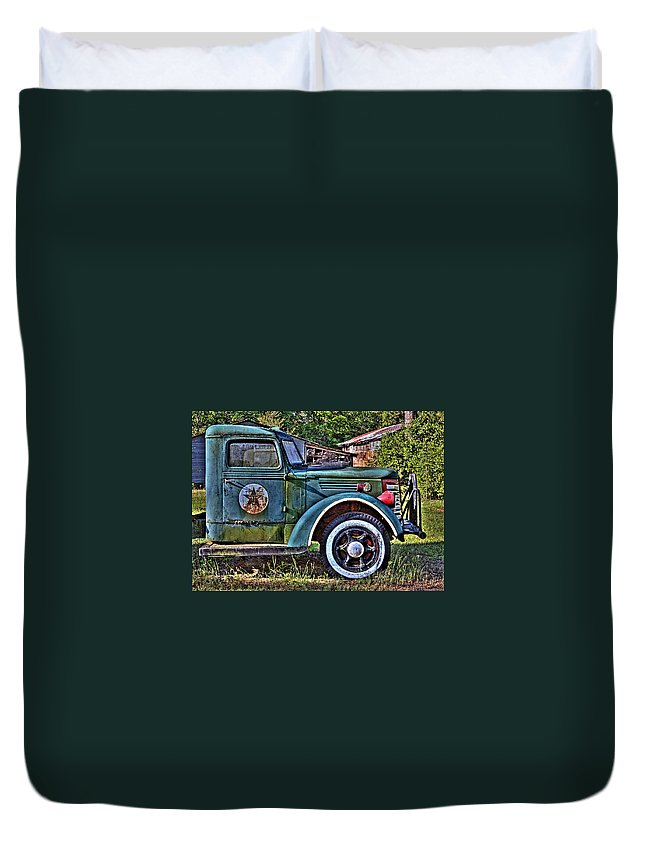 Old Texaco Truck Duvet Cover featuring the photograph The Sign Of The Star by Danny Pickens