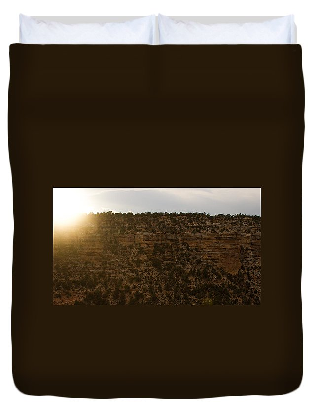 Grand Canyon Duvet Cover featuring the photograph The Sun Sets Behind The Canyon by Kathleen Odenthal