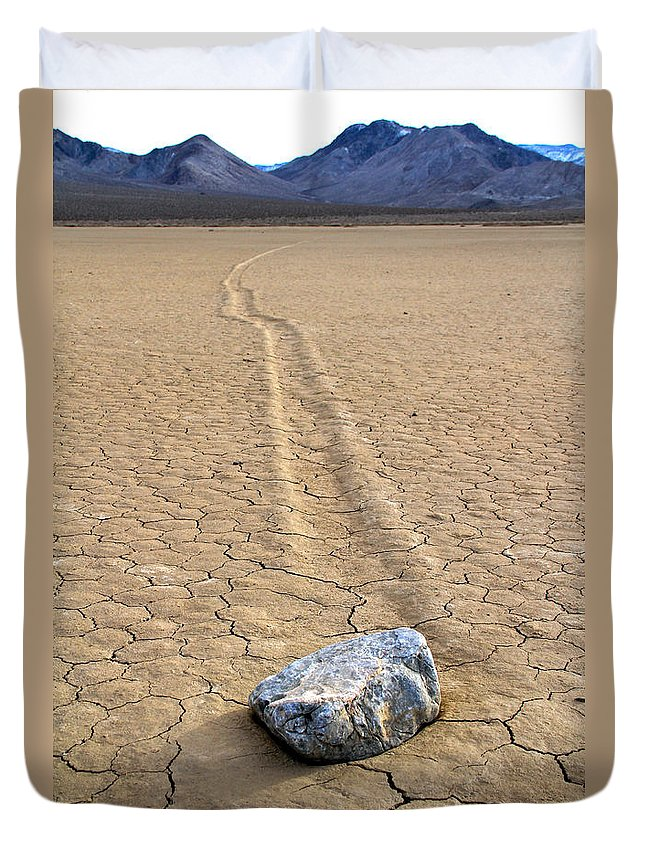 California Duvet Cover featuring the photograph The Winner Death Valley Moving Rock by Ed Riche