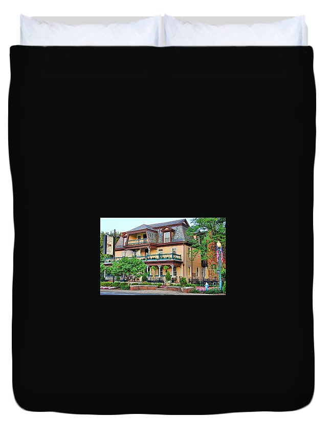 The Worthington Inn Duvet Cover featuring the photograph The Worthington Inn by Jack Schultz