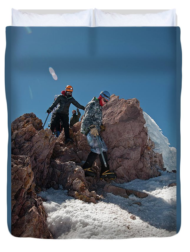 Young Man Duvet Cover featuring the photograph Three People Climb Down Rocks by Beth Wald
