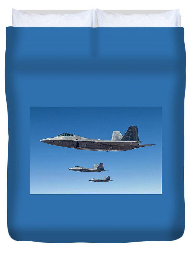 Formation Flying Duvet Cover featuring the photograph Three U.s. Air Force F-22 Raptors by Rob Edgcumbe/stocktrek Images