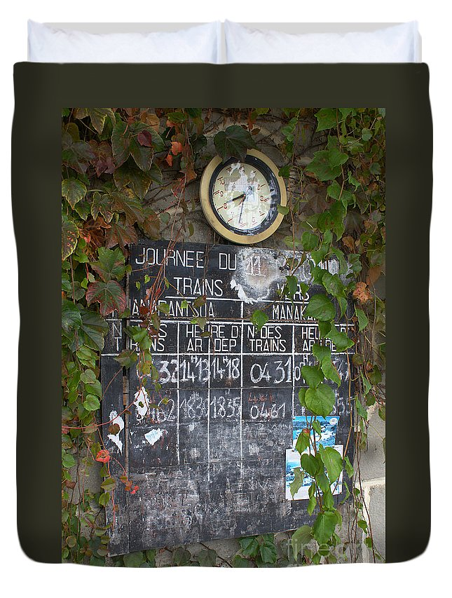 Madagascar Duvet Cover featuring the photograph timetable from a Madagascan train station by Rudi Prott