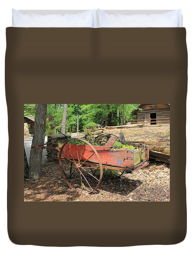 Red Trailer Duvet Cover featuring the photograph Trailer Flowerbed by Mary Koval