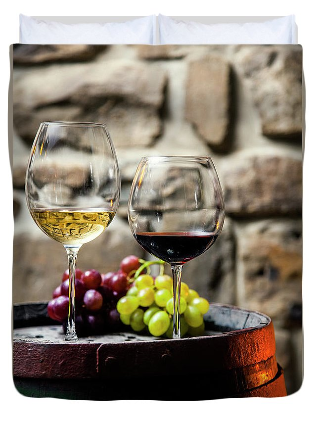 Alcohol Duvet Cover featuring the photograph Two Glasses Of Red And White Wine In by Piranka