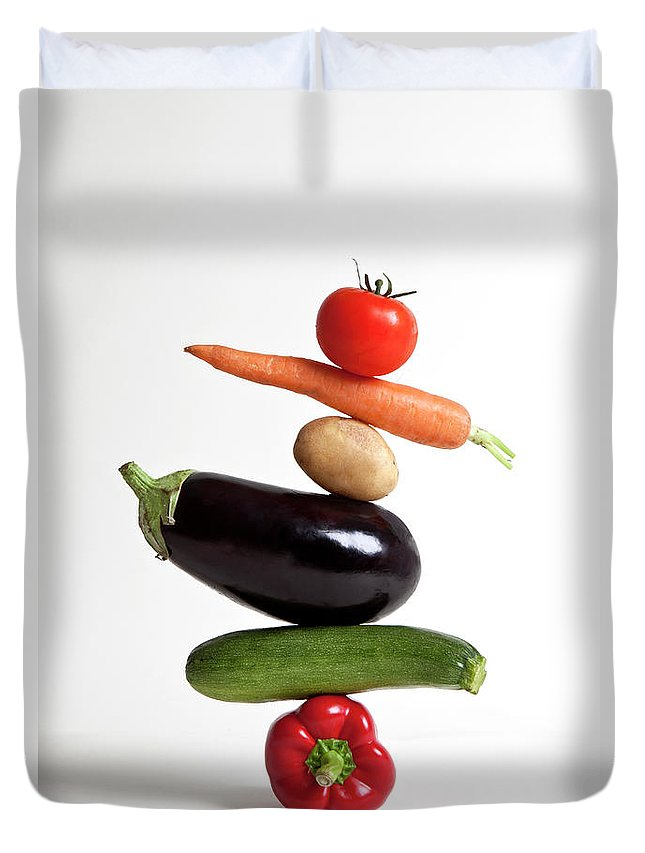 Shadow Duvet Cover featuring the photograph Vegetables Arranged In A Stack by Halfdark