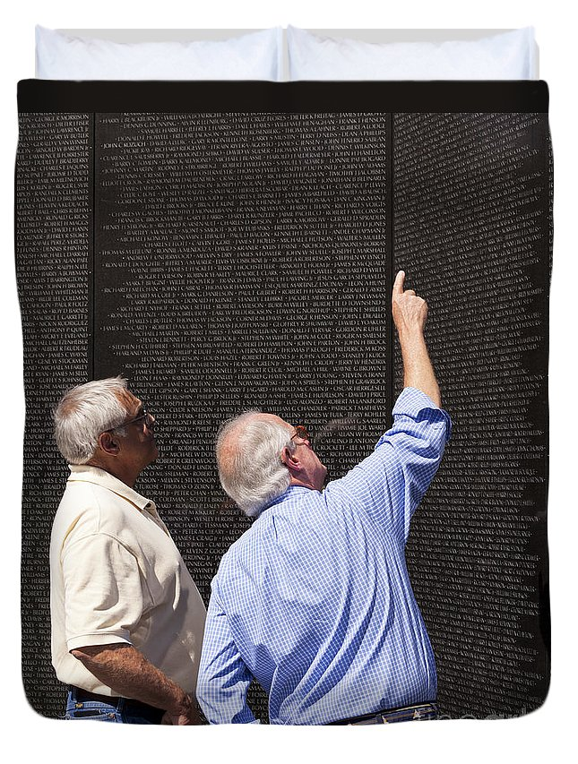 Veterans Duvet Cover featuring the photograph Veterans Look For A Fallen Soldier's Name On The Vietnam War Memorial Wall by B Christopher