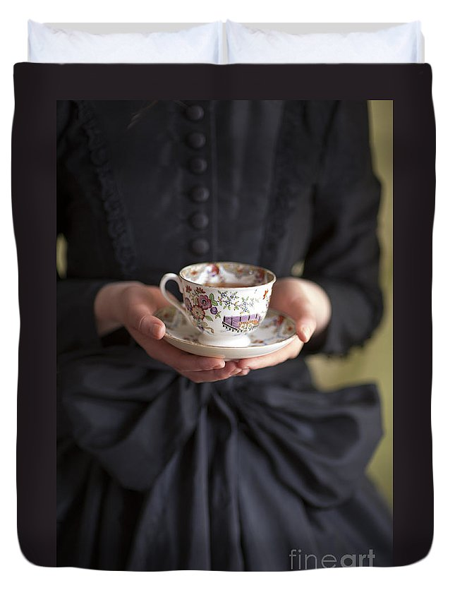 Woman Duvet Cover featuring the photograph Victorian Woman Holding A China Cup And Saucer Of Tea by Lee Avison