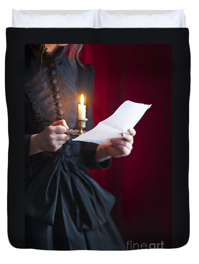 Woman; Victorian; Edwardian; 19th Century; 18th Century; Detail; Close Up; Mid Section; Indoors; Inside; Dress; Buttons; Hands; Hold; Holds; Holding; Alone; Single; One; Read; Reads; Reading; Letter; Paper; Correspondence; Message; Love Letter; Candle; Candlelight; Light; Lit; Candle Holder; Wee Willie Winkie; Black; Red Duvet Cover featuring the photograph Victorian Woman Reading A Letter By Candle Light by Lee Avison