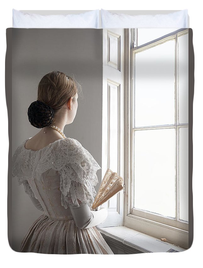 Victorian Duvet Cover featuring the photograph Victorian Woman With A Fan At The Window by Lee Avison