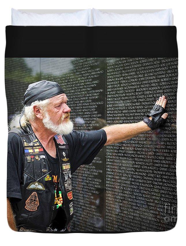 Memorial Duvet Cover featuring the photograph Vietnam Veteran Pays Respect To Fallen Soldiers At The Vietnam War Memorial by B Christopher