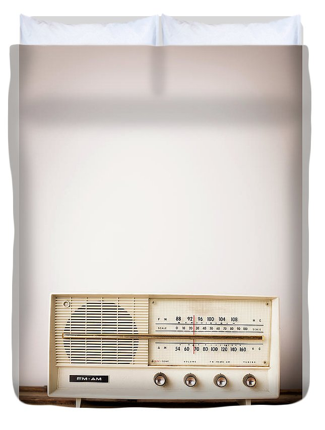 Desaturated Duvet Cover featuring the photograph Vintage Beige Radio Sitting On Wood by Ideabug