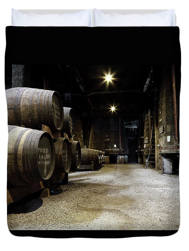 Desaturated Duvet Cover featuring the photograph Vintage Porto Wine Cellar by Vuk8691