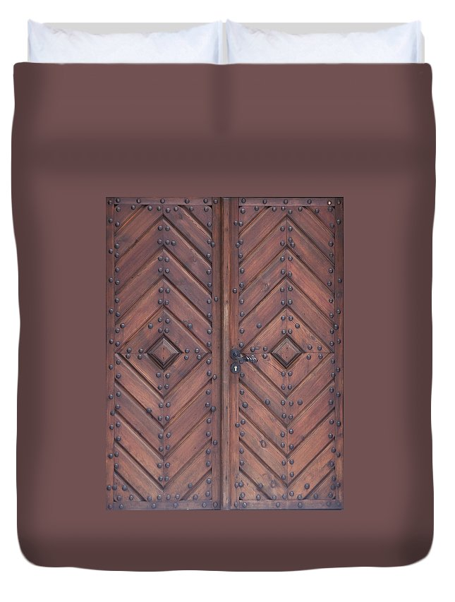 Material Duvet Cover featuring the photograph Vintage Wooden Brown Door Close-up by Bogdan Khmelnytskyi