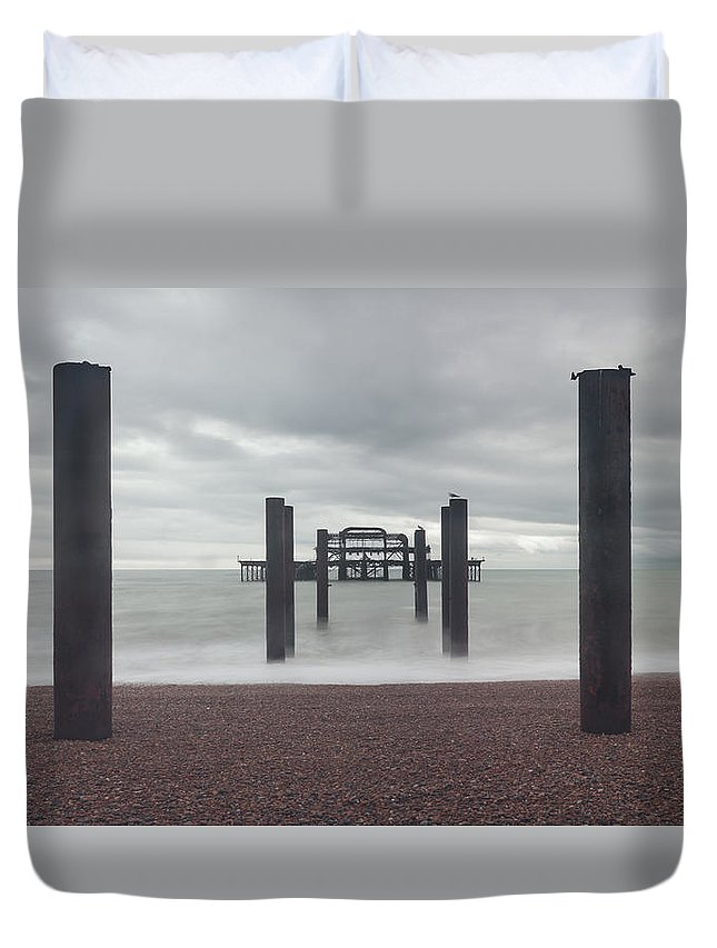 Clouds Duvet Cover featuring the photograph West Pier Skeleton In Brighton by Semmick Photo
