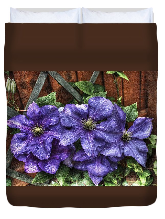 Duvet Cover featuring the photograph Wet Clematis by Paul Williams