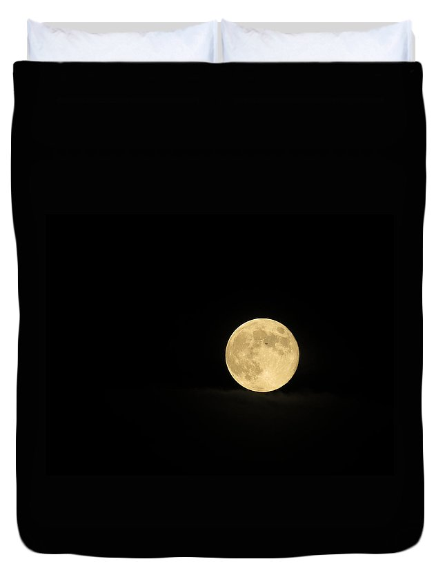Moon Duvet Cover featuring the photograph What's That Speck by Laurel Powell