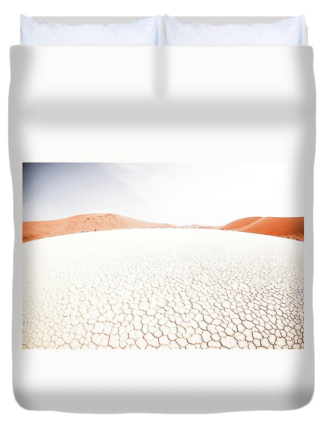 Tranquility Duvet Cover featuring the photograph White Clay Pan And Dunes by Taken By Chrbhm