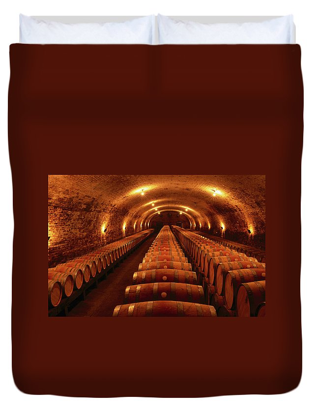 Alcohol Duvet Cover featuring the photograph Wine Barrels In Maturation Cellar by Oliver Strewe