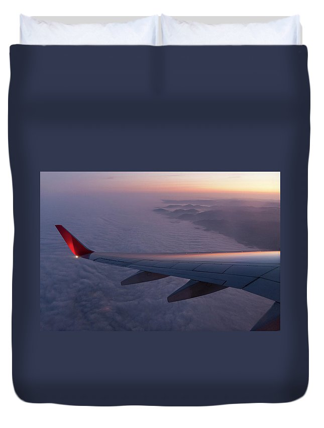Taking Off Duvet Cover featuring the photograph Wing Of An Aeroplane With Sunset by Rotofrank