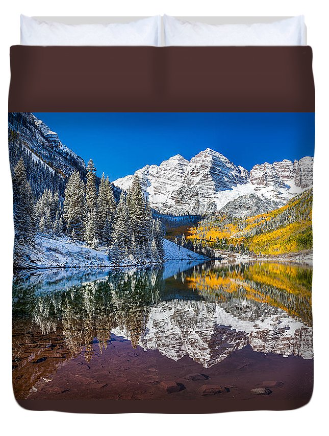 Aspen Duvet Cover featuring the photograph winter and Fall foliage at Maroon Bells by Kan Khampanya