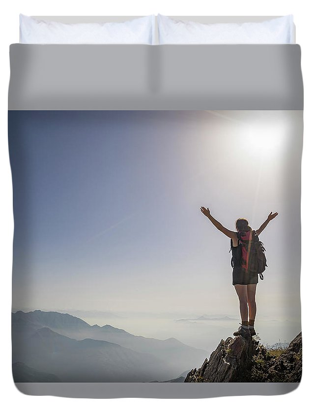 People Duvet Cover featuring the photograph Woman Exulting On A Mountaintop by Buena Vista Images