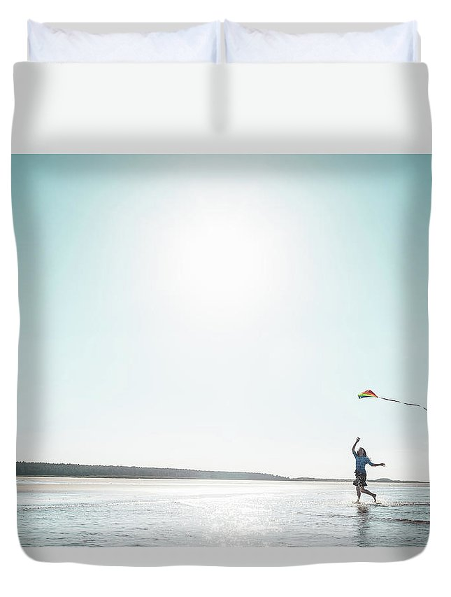 Three Quarter Length Duvet Cover featuring the photograph Woman Flying Kite On Beach by Dan Brownsword