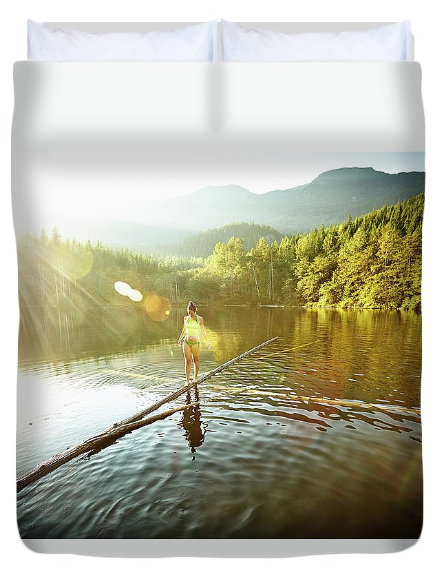 Pets Duvet Cover featuring the photograph Woman Walking On Log In Alpine Lake by Thomas Barwick