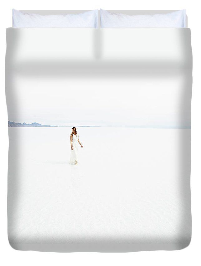 Scenics Duvet Cover featuring the photograph Woman Wearing Dress Walking Through by Thomas Barwick