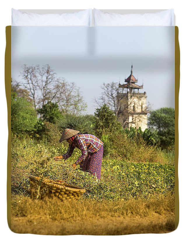 Three Quarter Length Duvet Cover featuring the photograph Woman Weeding At Nanmyin Tower by Merten Snijders