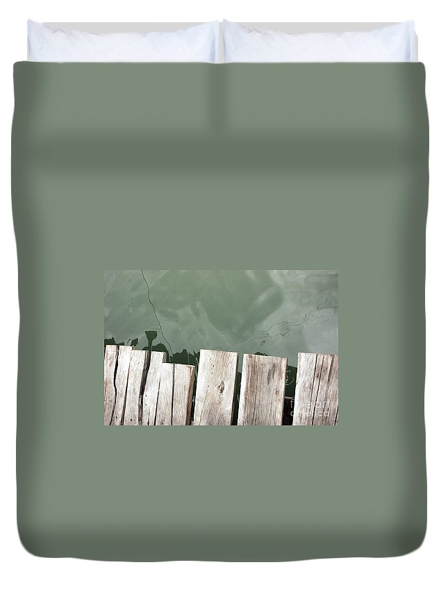 Texture Duvet Cover featuring the photograph Wooden Board Against Sea Surface by Antoni Halim