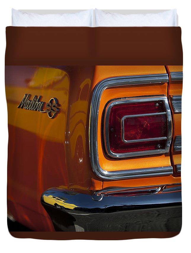 1965 Chevrolet Malibu Ss Duvet Cover featuring the photograph 1965 Chevrolet Malibu Ss Taillight Emblem by Jill Reger