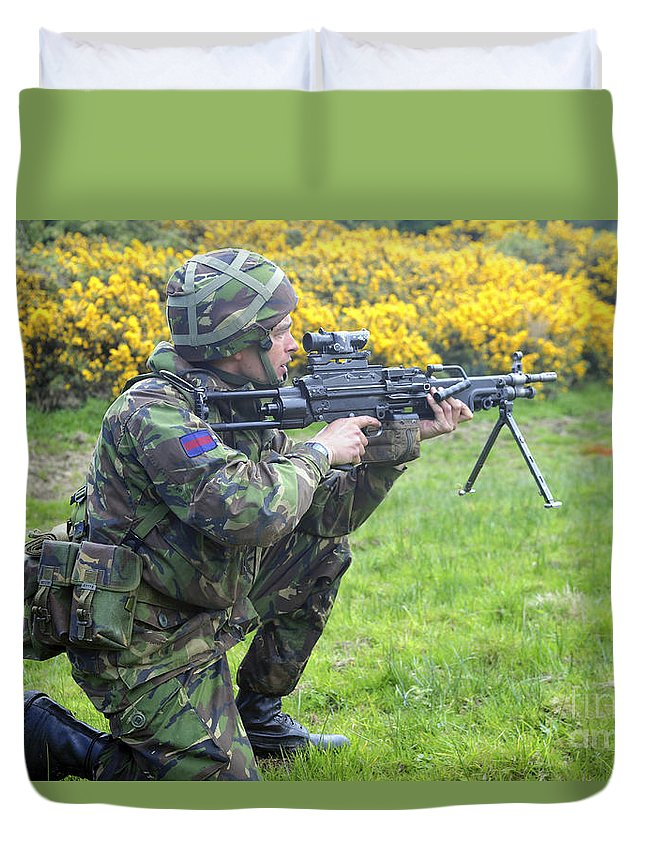 Aiming Duvet Cover featuring the photograph A Coldstream Guard Training In Scotland by Andrew Chittock