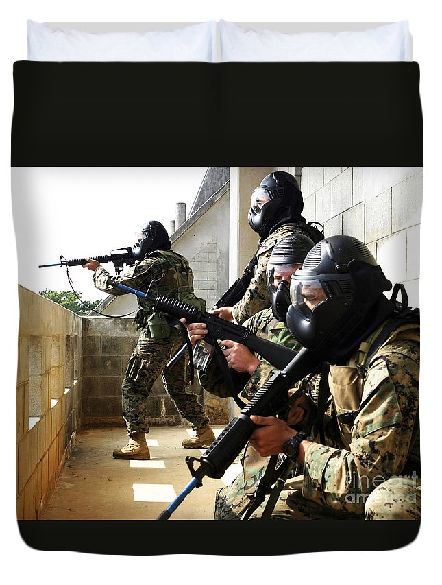 Adults Only Duvet Cover featuring the photograph A Fire Team Returns Fire From A Balcony by Stocktrek Images