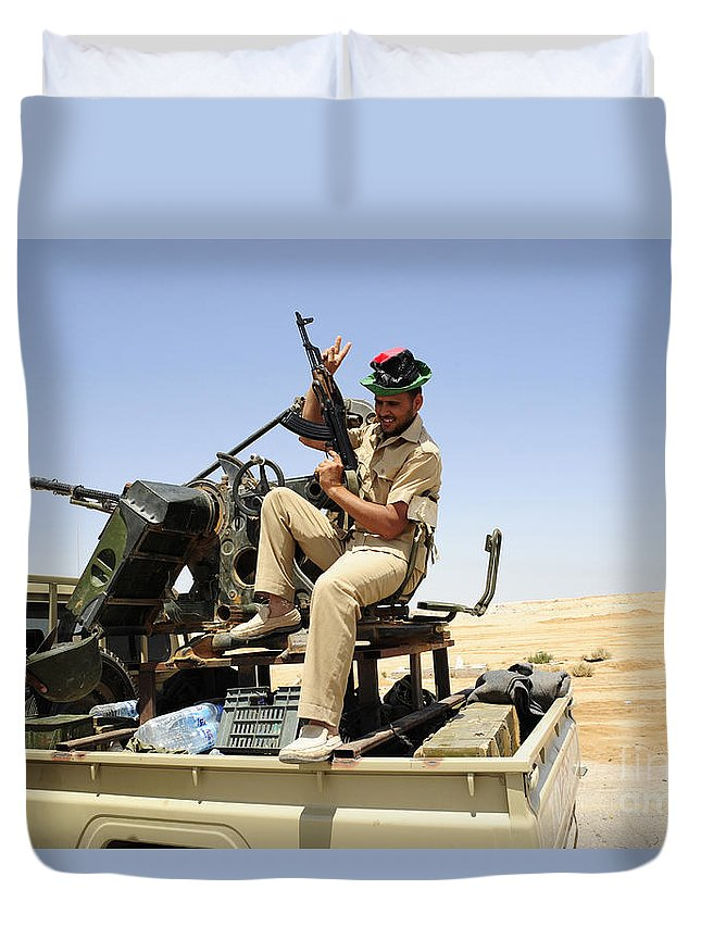 Ajadabiya Duvet Cover featuring the photograph A Free Libyan Army Pickup Truck by Andrew Chittock